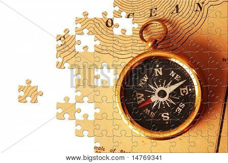 Puzzle Antique brass compass over old USA map background