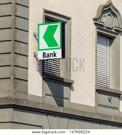 Rapperswil, Switzerland - September 12, 2016: sign on the wall of an St. Gallen Cantonal bank office. Cantonal banks are Swiss state-owned commercial banks.