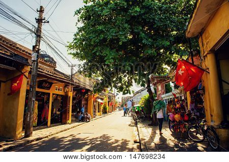 Hoi An, Vietnam - September 02, 2013: The tourist is walking in the street in the afternoon