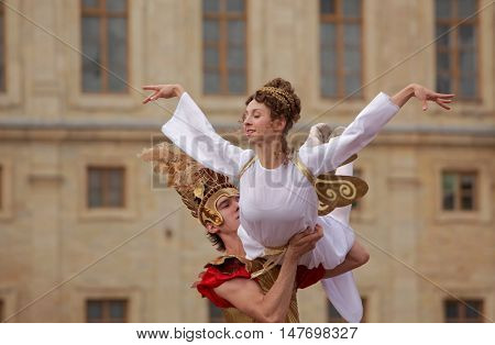 GATCHINA, ST. PETERSBURG, RUSSIA - SEPTEMBER 10, 2016: Actors in images of Roman Emperor and Angel in the show during the festival Gatchinskaya Byl. The festival is held first time this year