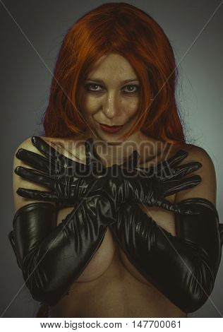 redhead woman with black latex gloves, bare