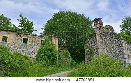 Derelict farming buildings in the historic village of Jelovice in Primorje-Gorski Kotar County in northern Croatia.