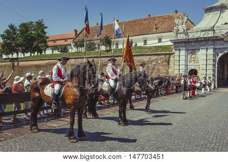 Alba Iulia, Romania - July 24, 2016: Tourists watch the changing of guards a unique military ceremony in Transylvania at the third gate of Alba Carolina Citadel.