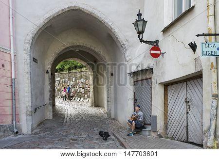 Tallinn Estonia - July 29th 2016: Street musician in Old Town of Tallinn