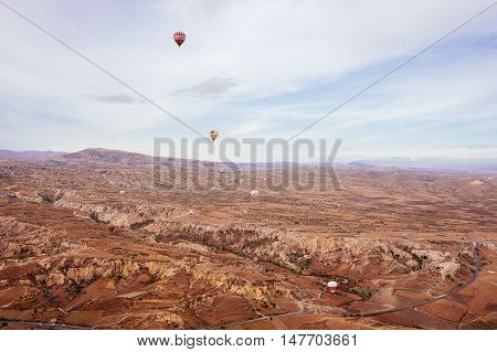 GOREME, CAPPADOCIA, TURKEY - OCTOBER 24, 2015: Cappadocia, Turkey.The greatest tourist attraction of Cappadocia, the flight with the hot air balloons over the valley in Goreme