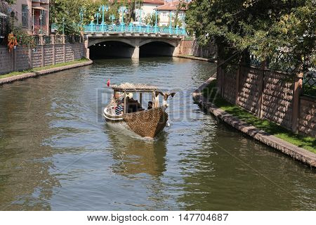 ESKISEHIR TURKEY - SEPTEMBER 04 2016: People in Gondola tour in Porsuk river. Porsuk river is one of the most populer touristy place with boat tours and entertainment in Eskisehir.