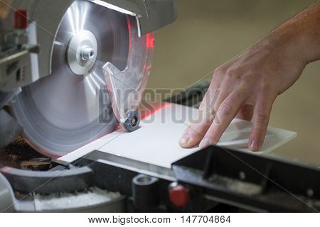 Circular Saw. Carpenter Using Circular Saw for metal