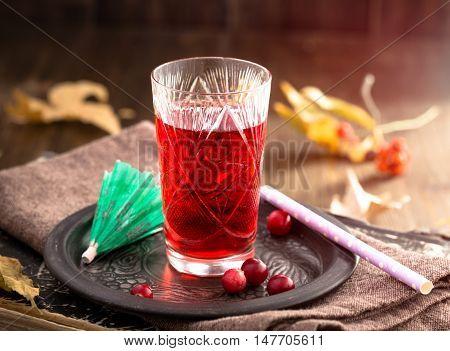 Shot glass of liquor on metal plate