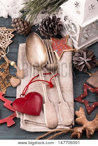 Silverware and christmas decorations on festive table