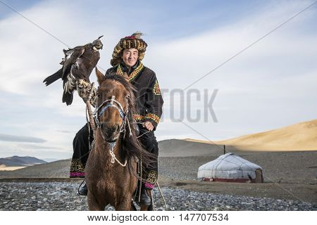 Bayan Ulgii Mongolia September 30th 2015: Mongolian eagle hunter with his eagle and horse