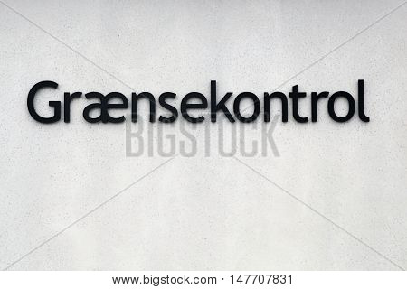 Border control sign called Graensekontrol in Danish on a wall in Denmark