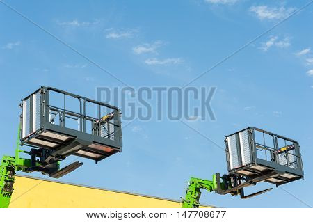 Forklift telescopic boom with buckets and aerial working platform.