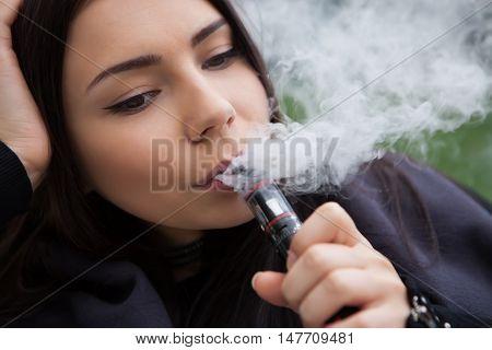 Young Girl Vaping E-cig Vaporizer Device