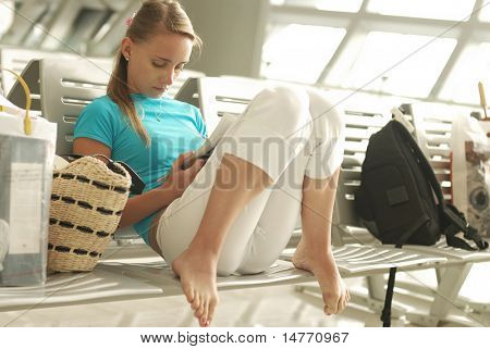 Woman waiting for a delayed flight