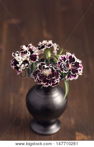 Sweet william flowers in a in ceramic bowl
