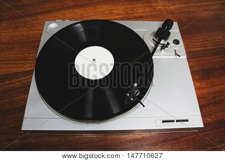Hipster Turntable Playing Vinyl Record With Music