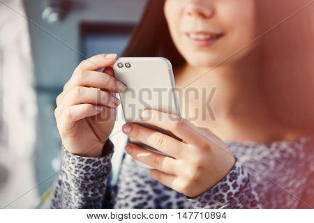Cute White Girl Using Modern Dual Camera Smart Phone