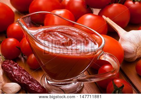 Red tomato sauce in glass saucer closeup