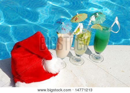 Santa hat and cocktails near the swimming pool