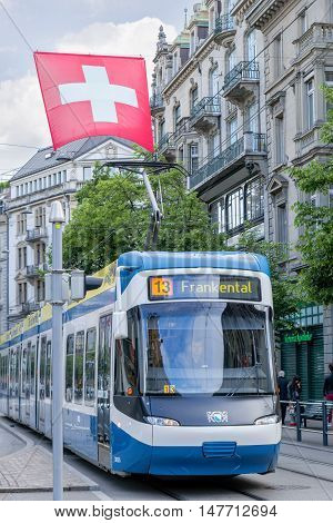 ZURICH, SWITZERLAND - JUNE 4, 2016: Tram on a street in Zurich. Trams have been a consistent part of Zurich's streetscape since the 1880s, when the first horse tram ran. Electrified from the 1890s.