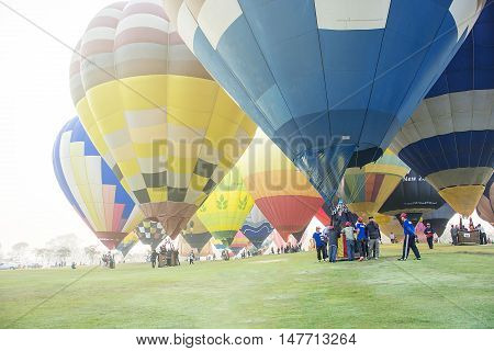 CHIANG RAI THAILAND - FEBRUARY 14 : Hot air Balloons ready to rise into the sky in the morning at SINGHA PARK CHIANG RAI BALLOON FIESTA 2016 Chiang rai province Thailand