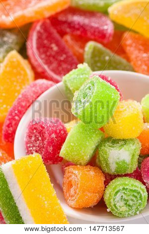 Various fruit sweet candy vertical. Food background