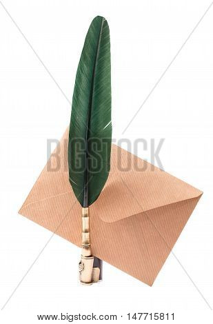 Vintage quill pen and envelope isolated on white