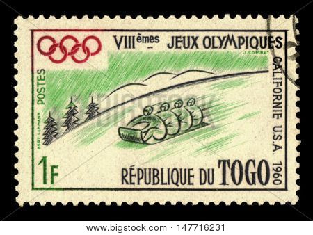 TOGO - CIRCA 1960: A stamp printed in Togo shows the Bobsleigh at the Winter Olympic Games in Squaw Valley with inscription and name of the series