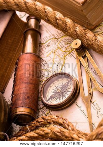 Vintage sea adventure concept. Medieval map, telescope and compass