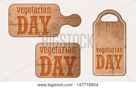 Wooden breadboard with the words vegetarian day