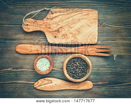 Wooden kitchenware with salt and pepper top view.Toned