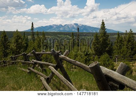 Wooden handmade fence with Pennock Mountain in the background. Medicine Bow National Forest, Wyoming