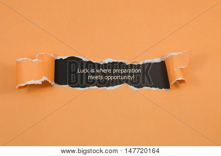 The quote Luck is where preparation meets opportunity, appearing behind torn paper.
