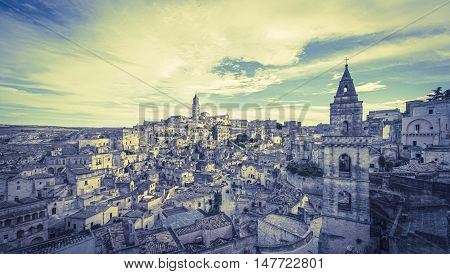 Panoramic View Of Typical Stones (sassi Di Matera) And Church Of Matera Under Blue Sky, Artistic Sty
