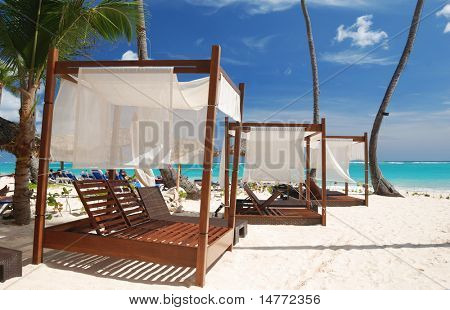 Luxury wooden chaise lounge on beautiful caribbean beach in Dominican Republic