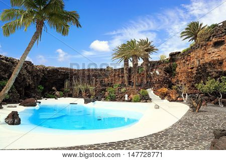 Beautiful swimming pool with tropical garden in Lanzarote
