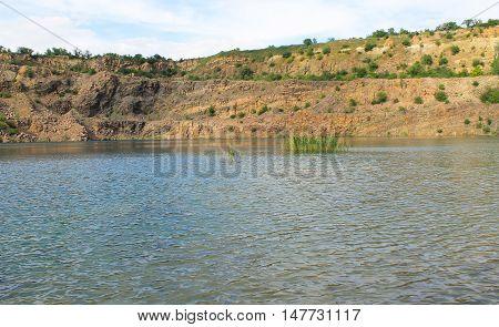 Beautiful lake at abandoned quarry on summer