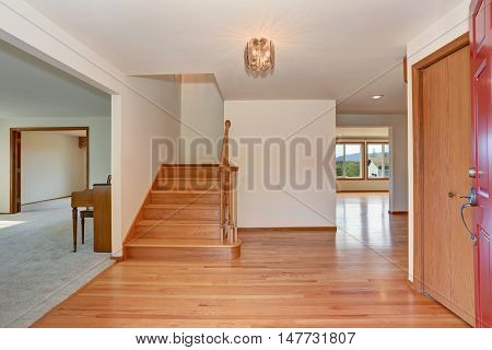 Hallway Interior With Hardwood Floor. View From Opened Front Door.