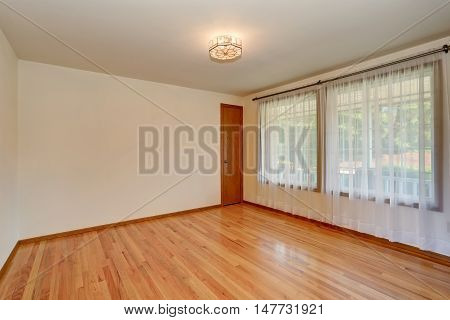 Empty Room Interior With Carpet Floor And Nice Chandelier