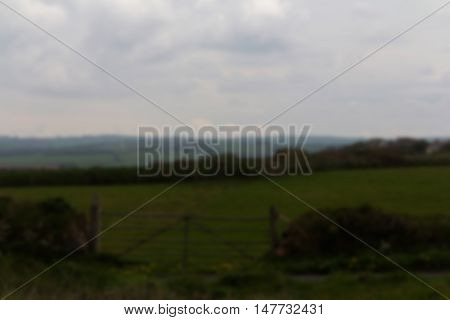 View Of A Gate On The Coastal Path In Cornwall Out Of Focus.