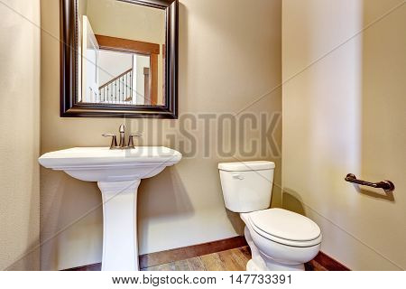 Bathroom Interior. View Of White Sink, Toilet And Mirror