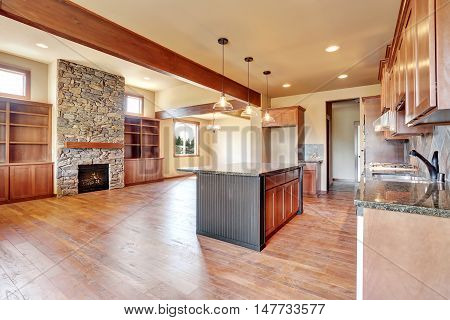 Kitchen Room With Wooden Cabinets, Island And Granite Counter Top