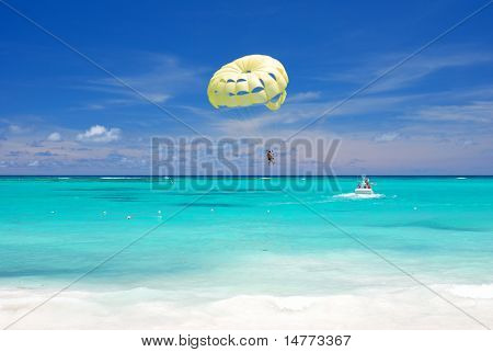 Beautiful caribbean beach in Dominican Republic. Unrecognizable people.