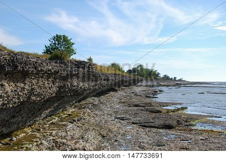 Overhang of eroded limestone cliffs at the swedish island Oland in the Baltic Sea