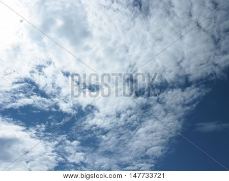 White clouds on blue sky. Clouds in the sky. Sky with clouds. Clouds background. Sky background. Heaven. Nature.