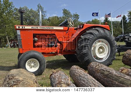 ROLLAG, MINNESOTA, Sept 1. 2016: The  orange Allis Chalmers D-19 is displayed at the West Central Steam Threshers Reunion in Rollag, MN attended by 1000's held annually on Labor Day weekend.