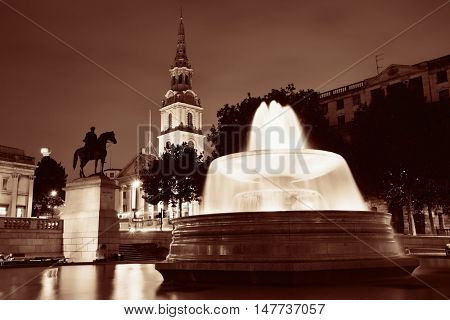 Trafalgar Square at night with fountain and  St martin in the field in London