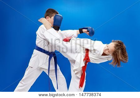 High kick leg and punch arm athletes are beating with overlays on hands