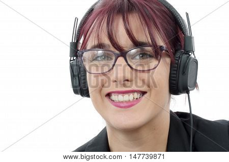 portrait of a beautiful young woman with headphones and glasses