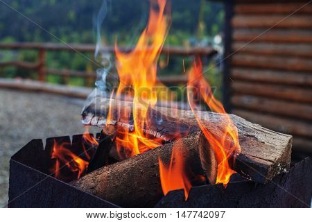bright fire in the grill. The concept of travel and lifestyle